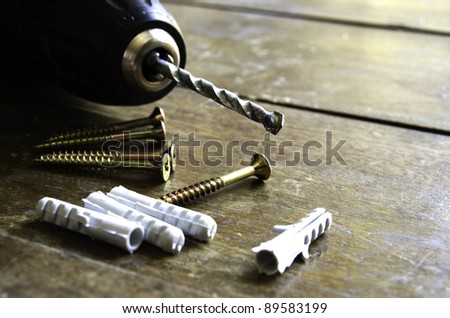 Construction tools over a wooden background - stock photo