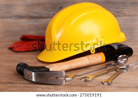 Construction tools with helmet on table close up