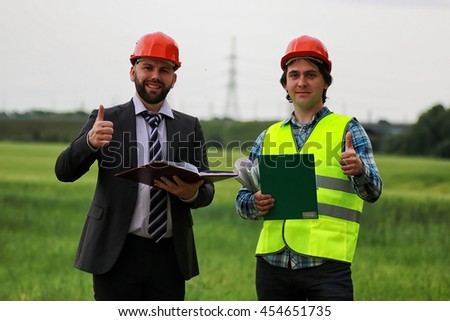 construction two man in the field - stock photo