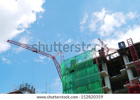 Construction with crane blue sky background.