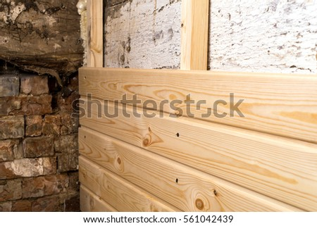 construction wood paneling covers the walls obsolete.
