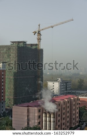 Construction work and air pollution (smog) in Beijing - stock photo