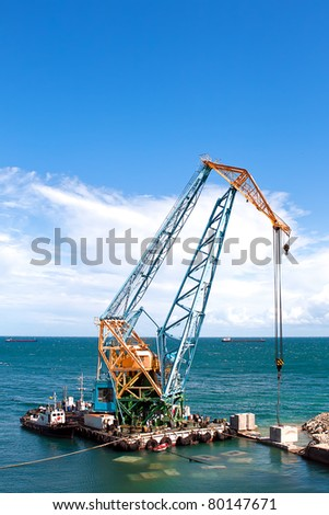 Construction work at the port dock crane - stock photo
