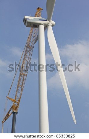 Construction work on a wind turbine - stock photo