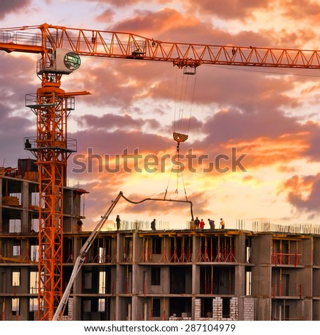 Construction work site on sunset - stock photo