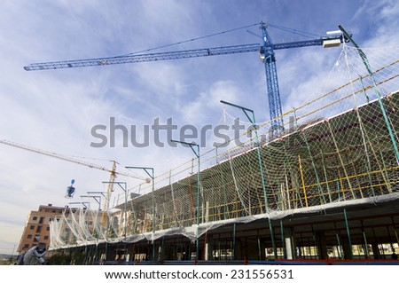 Construction work site with cloudy sky