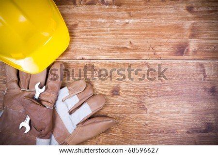 Construction Work Tool on wood table and copy space - stock photo