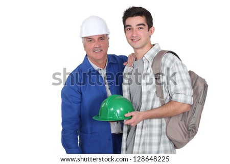 Construction worker and his apprentice - stock photo