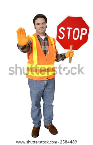 construction worker at a work site, directing traffic - stock photo