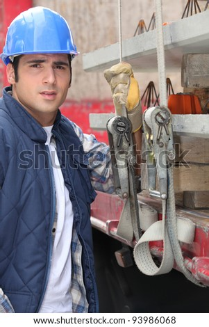Construction worker at the back of a lorry - stock photo