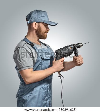 construction worker builder with drill on the isolated background - stock photo
