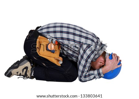 Construction worker curled up - stock photo