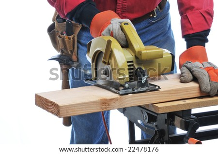 Construction Worker Cutting Beam with circular saw isolated over white
