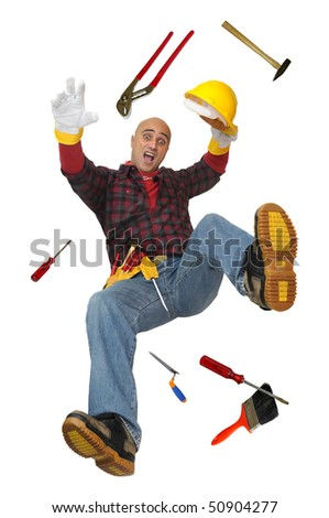 Construction worker falling with tools isolated in white - stock photo