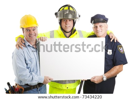 Construction worker, fireman, and policeman holding a blank white sign.  Isolated on white. - stock photo
