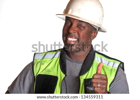 Construction worker giving thumb up - stock photo