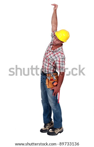 Construction worker hanging in empty space - stock photo
