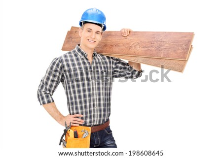 Construction worker holding a couple of planks isolated on white background - stock photo