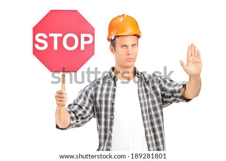Construction worker holding a stop sign isolated against white background - stock photo
