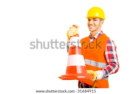 Construction worker holding a traffic cone - stock photo