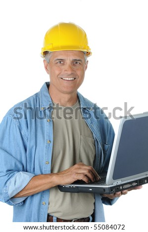 Construction Worker Holding Laptop and smiling at the camera. Vertical Format isolated over white. Man is wearing a yellow hardhat and work shirt. - stock photo
