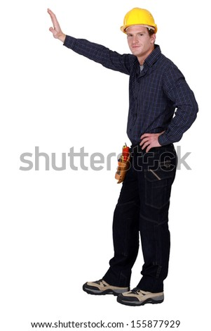 Construction worker holding out hand - stock photo