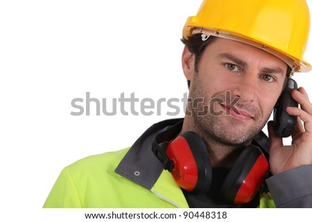 Construction worker holding radio receiver - stock photo