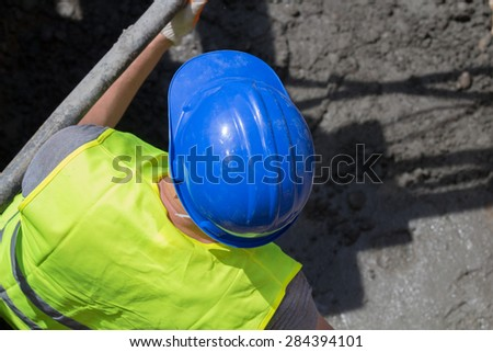 Construction worker in a ditch doing hard work. - stock photo