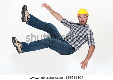 Construction worker in freefall. - stock photo