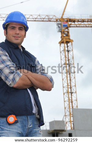 Construction worker in front of a crane - stock photo