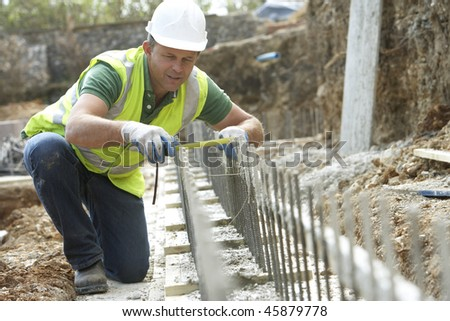 Construction Worker Laying Foundations - stock photo