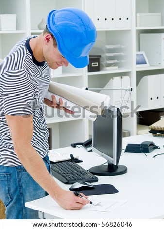 construction worker looking at the diagrams and blueprints - stock photo