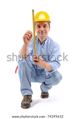 Construction worker measuring the wall over white background - a series of MANUAL WORKER images. - stock photo