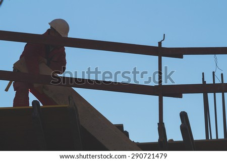 Construction worker on a high building. - stock photo