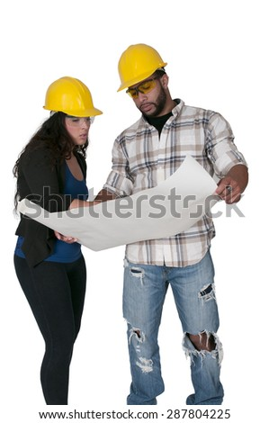 Construction Worker on a job site inspecting blueprints