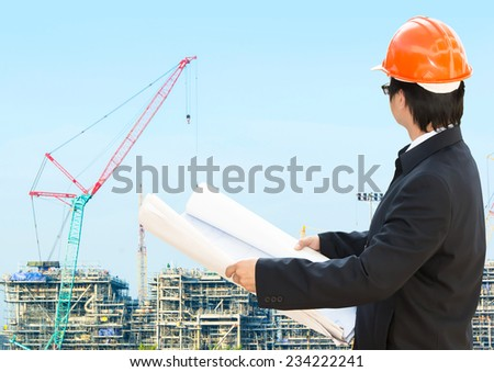 construction worker  on background of building construction  - stock photo