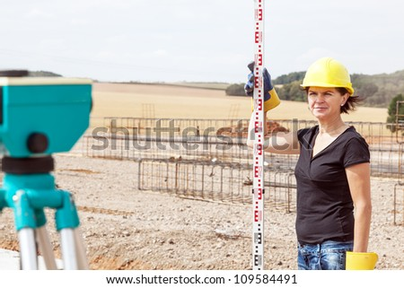 Construction worker on site at the measure