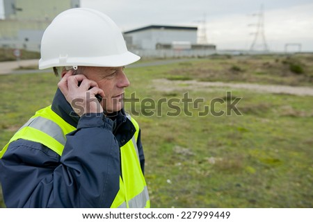 Construction Worker On Telephone - stock photo