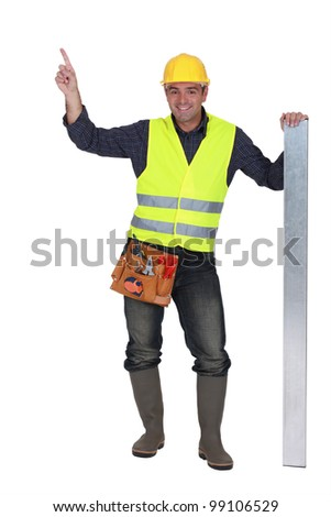 Construction worker pointing at empty copyspace - stock photo