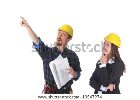 construction worker pointing on architectural plans and architect - stock photo