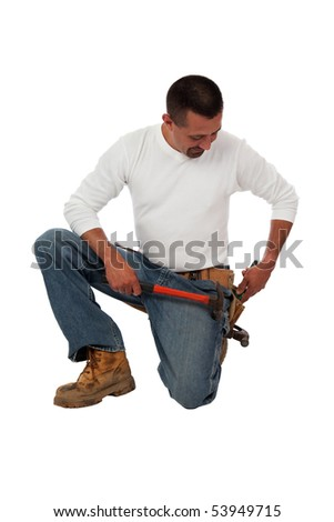 Construction Worker Reaching For A Tool Stock Photo