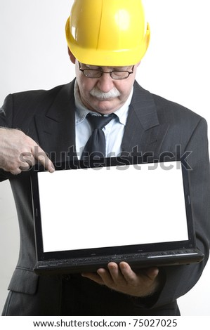 Construction worker showing laptop isolated screen - stock photo
