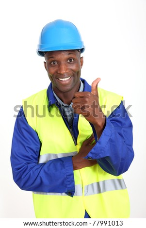 Construction worker showing thumb up - stock photo