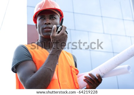 Construction worker speaking on Walkie-Talkie - stock photo
