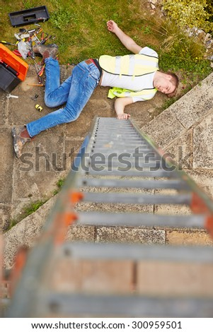 Construction Worker Suffering Injury After Fall From Ladder - stock photo
