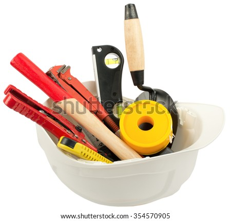 Construction worker supplies including hard hat on isolated white background - stock photo