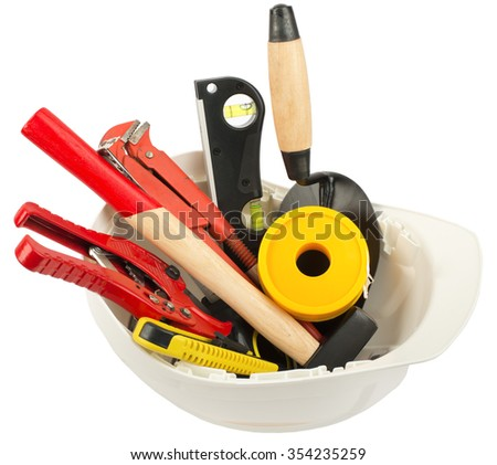 Construction worker supplies including hard hat on isolated white background, closeup - stock photo
