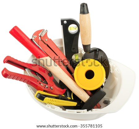Construction worker supplies including  white hard hat on isolated white background, closeup - stock photo