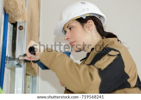construction worker using a drill