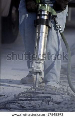 Construction Worker using Jack Hammer - stock photo